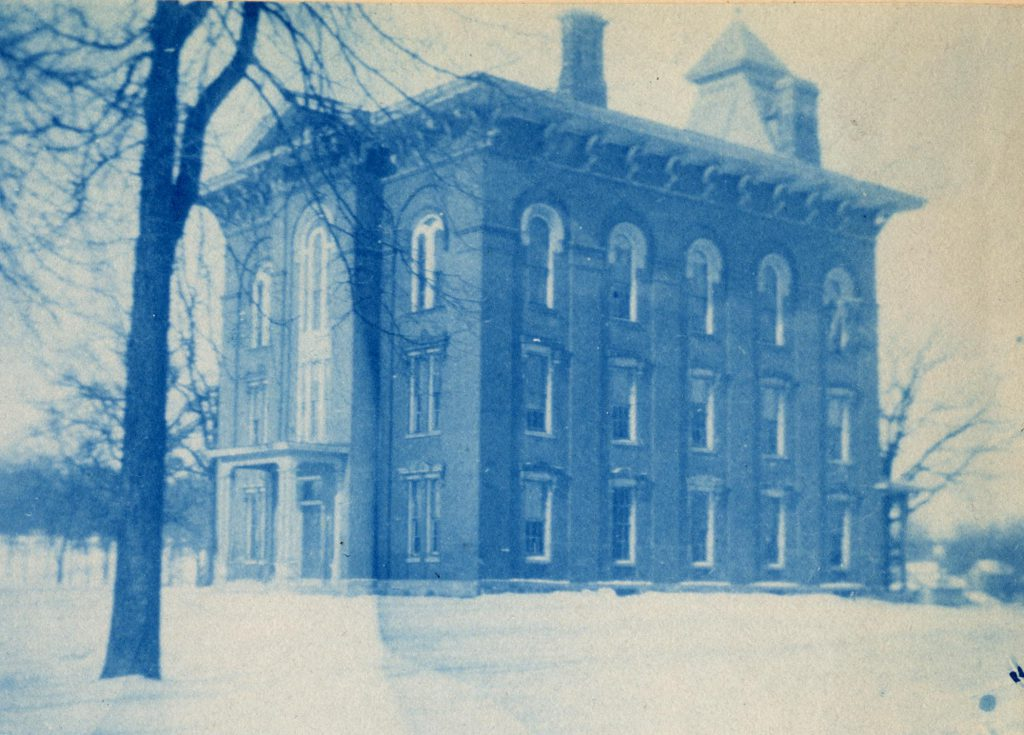 A cyanotype image of the 3 story, brick building known as Preparatory Hall.