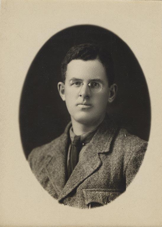 A portrait photo of Maynard Owen Williams, Class of 1910, taken around 1920.