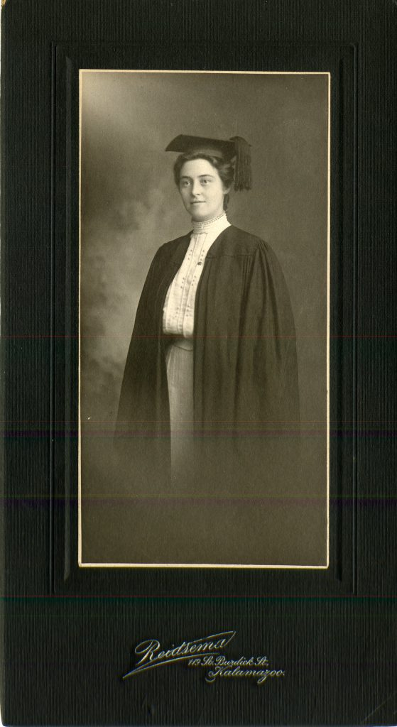 Black and white photo of Stella Fisher Burgess '05 in her black graduation cap and gown.